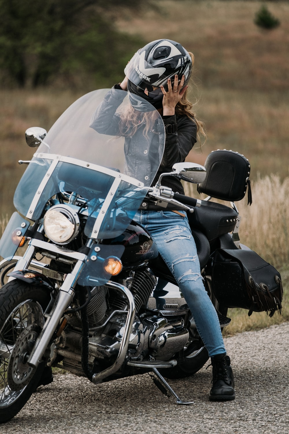 woman riding on black and gray motorcycle
