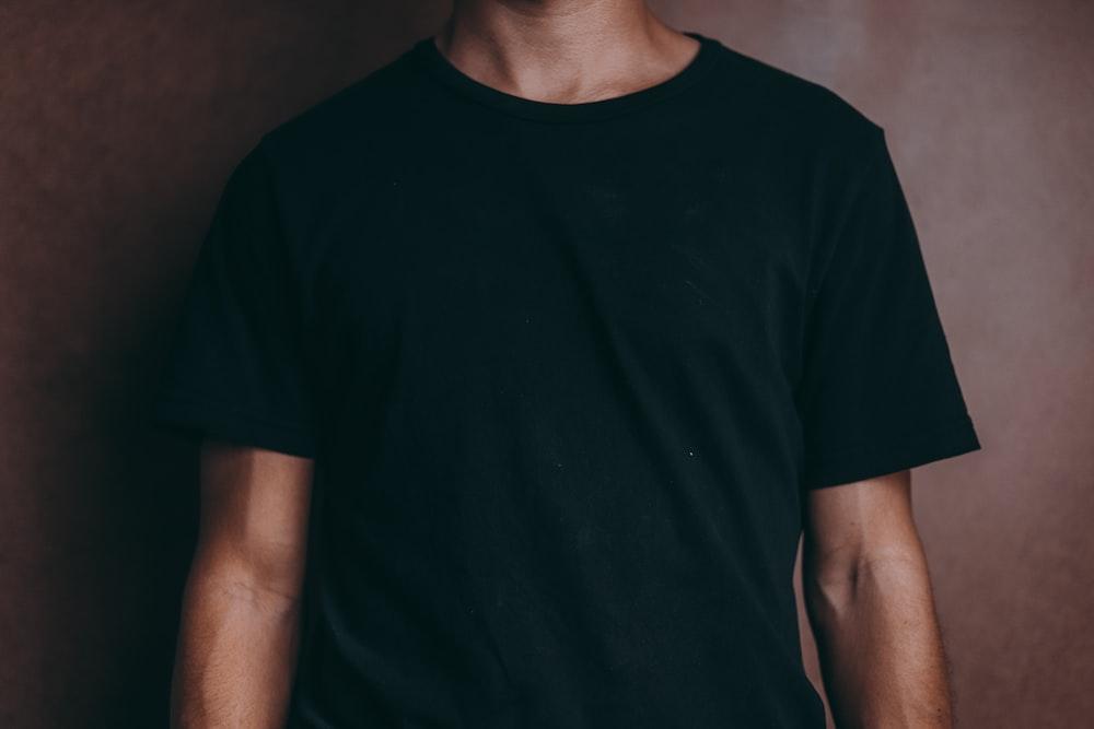 man wearing black crew-neck t-shirt