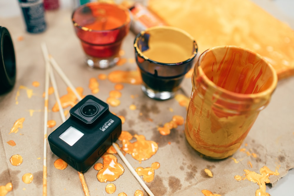 action camera beside cups