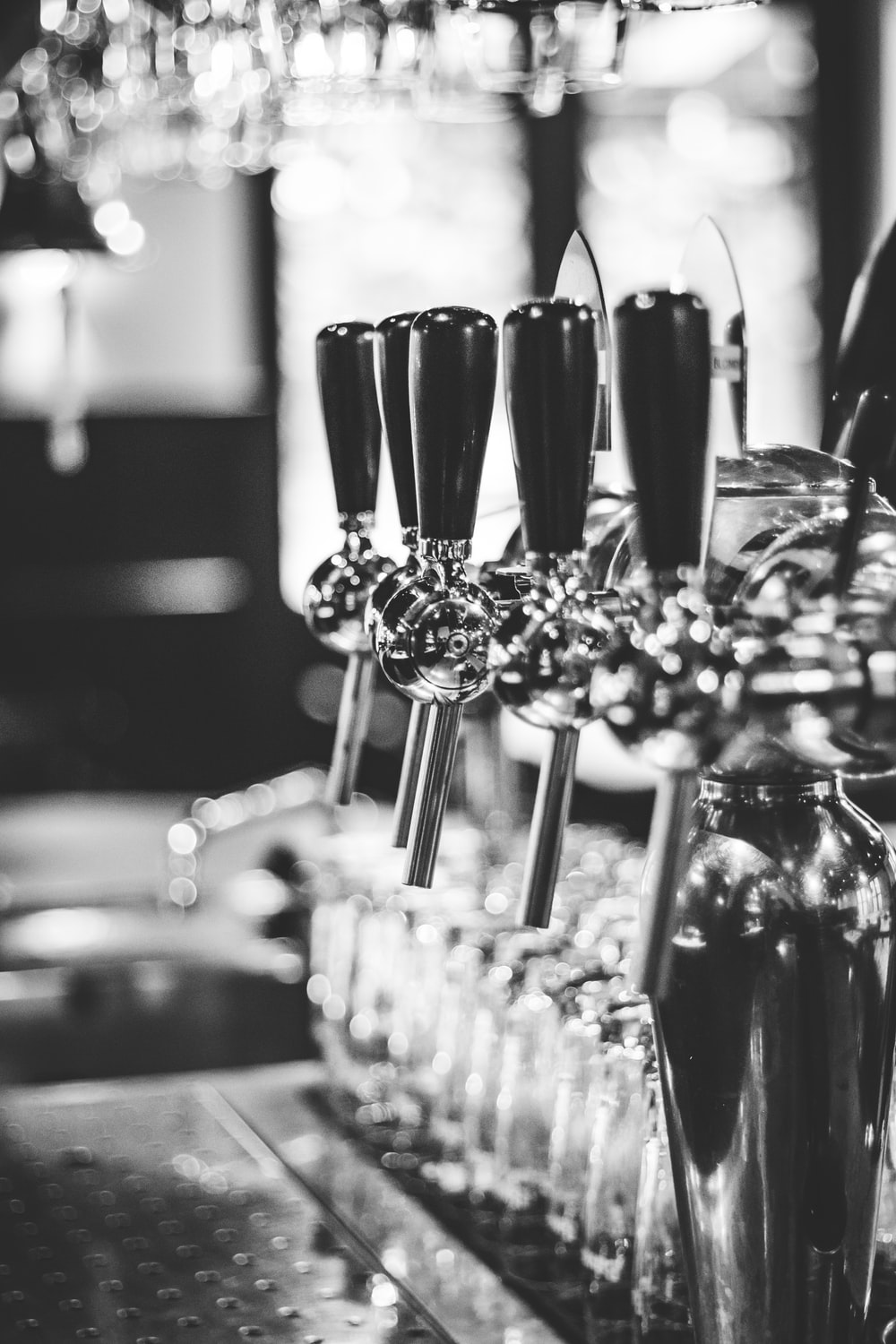 grayscale photography of beer tap handle
