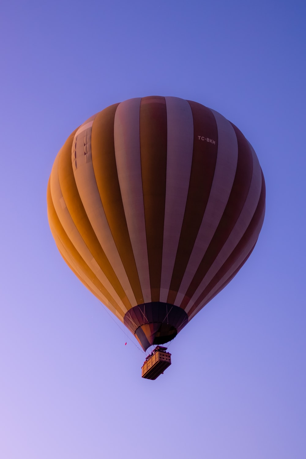 yellow and white hot air balloon in the sly during daytime
