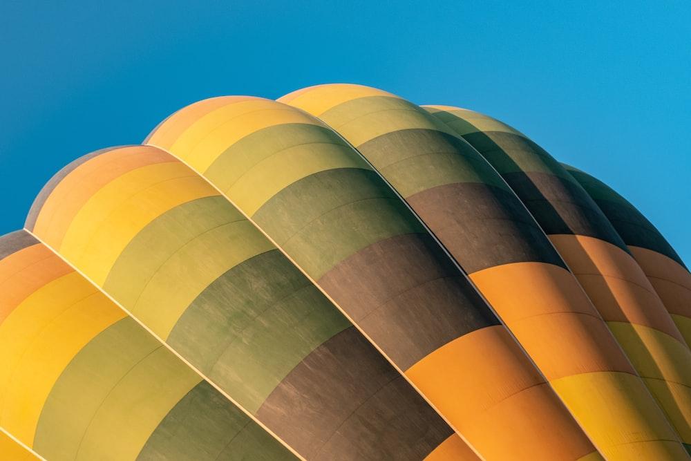 orange, green, and gray hot air balloon