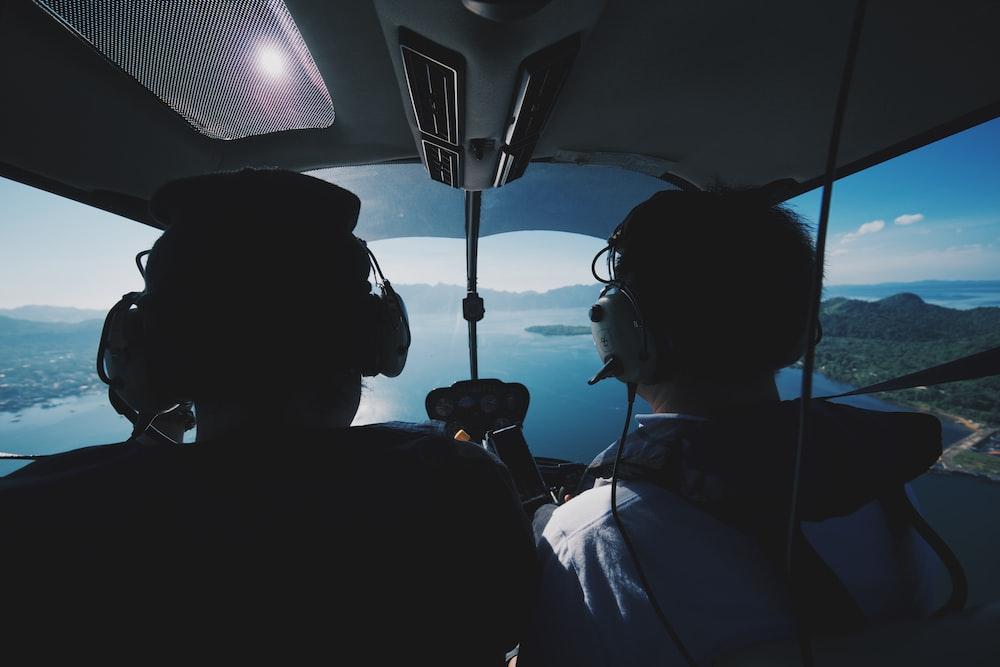 two pilot riding airplane