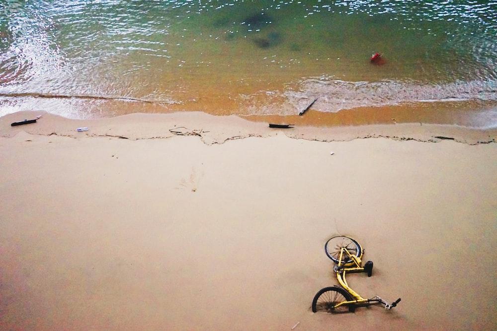 yellow bicycle near ocean