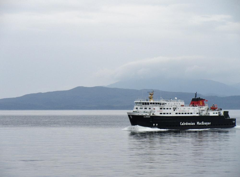 white and black ship on ocean