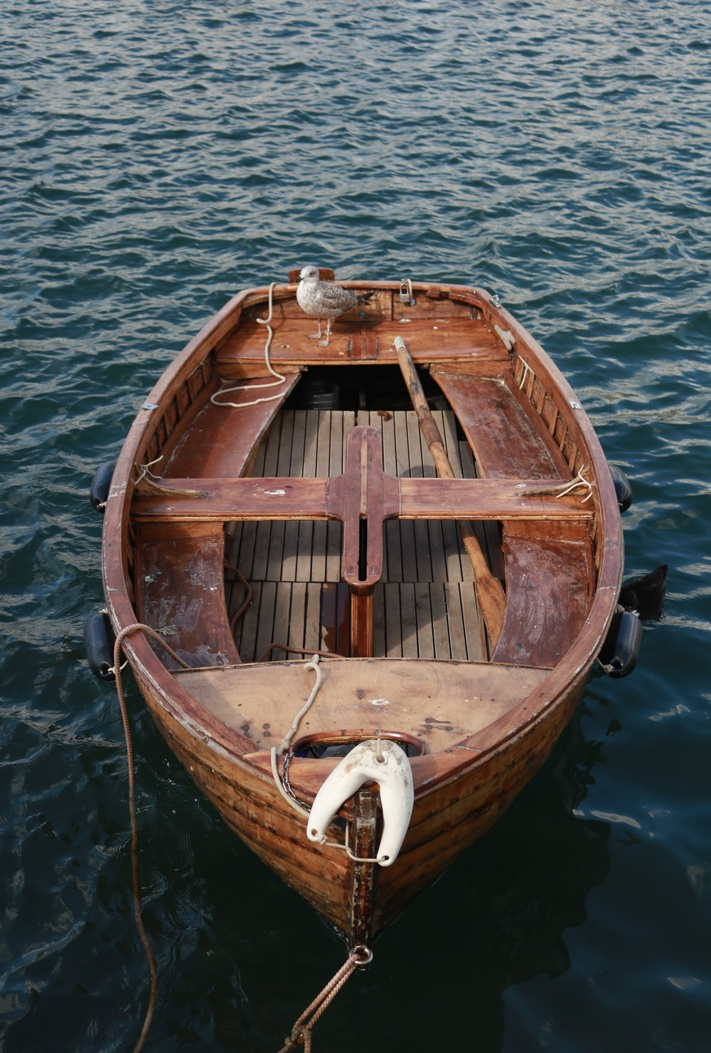 photo of brown wooden canoe boat