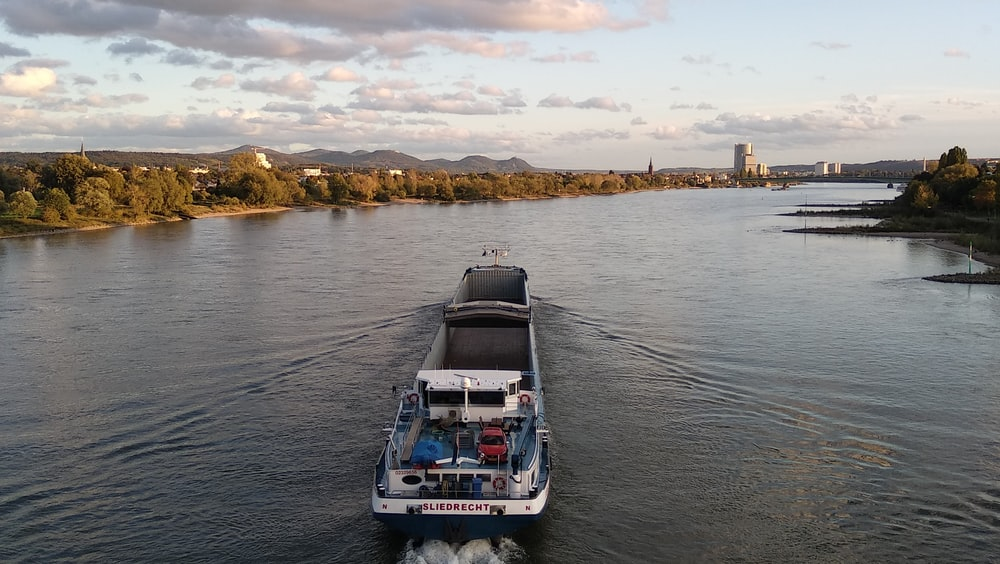 blue and white passenger boat