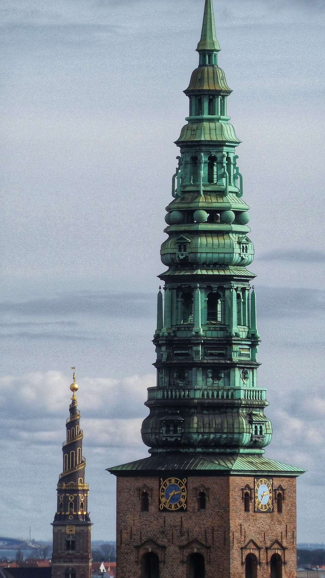 The spires of Nikolaj and The Church of our Saviour on a cloudy day in Copenhagen