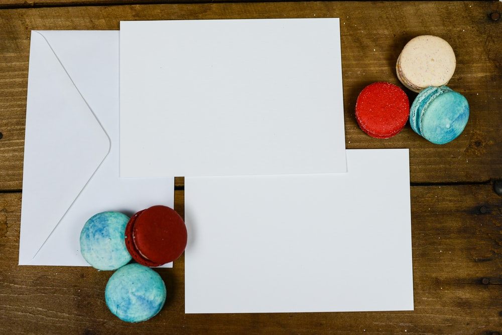 white envelopes and macarons