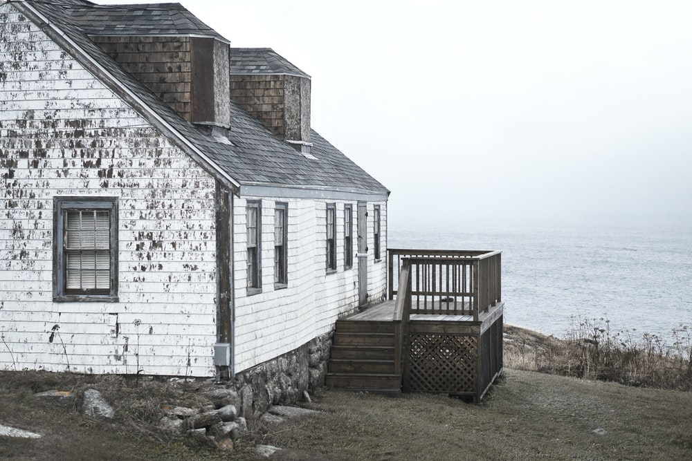 photo of white and brown wooden house