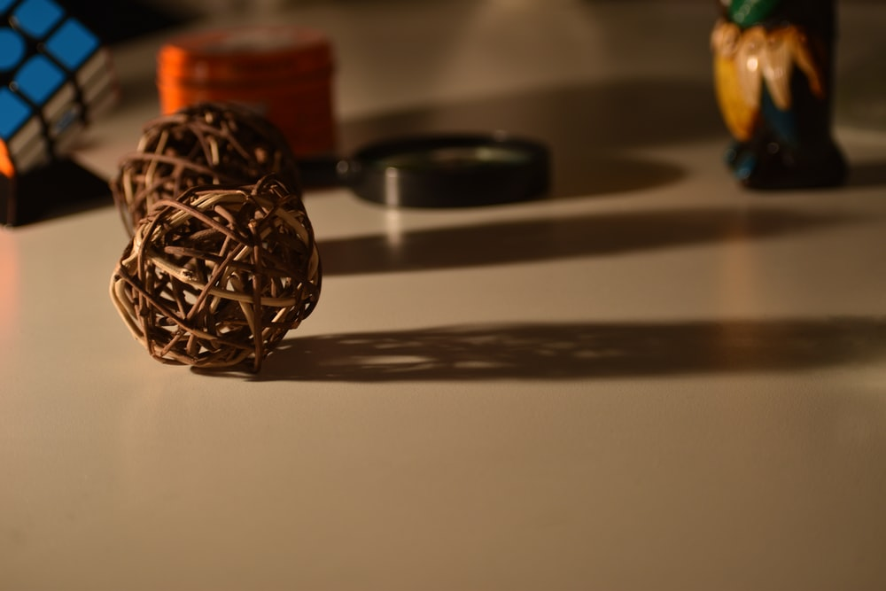 brown wicker balls on table