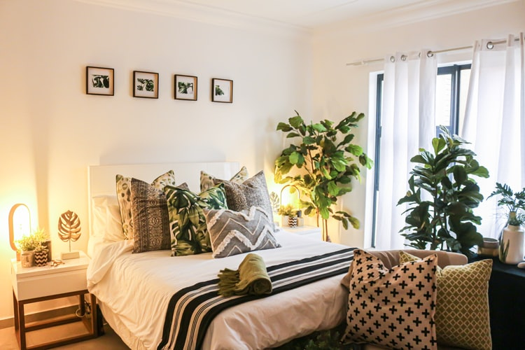Warm-toned bohemian-style bedroom filled with plants