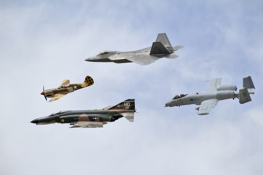 four grey jet planes