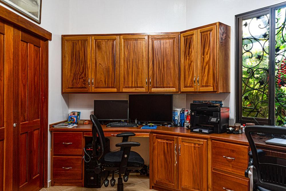 two monitors on desks