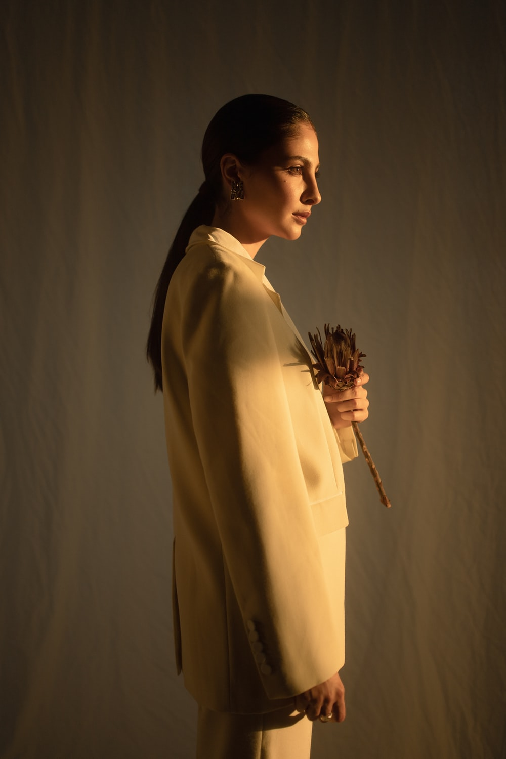 woman holding dried flower