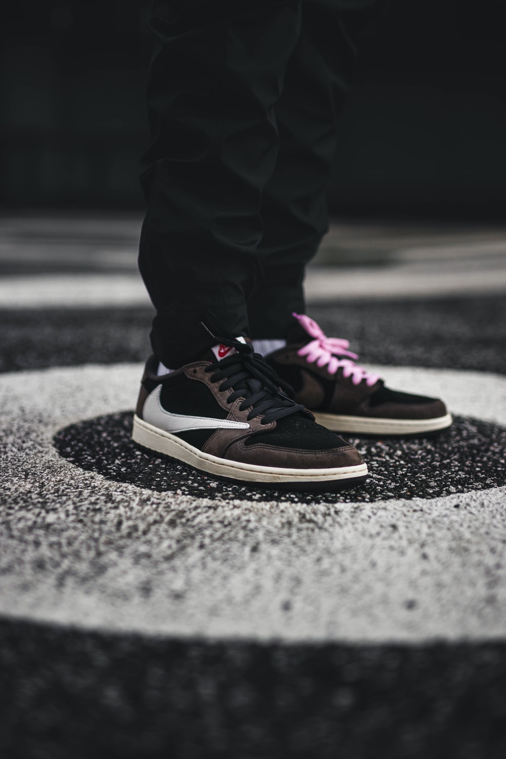 person wearing brown and white Nike sneakers