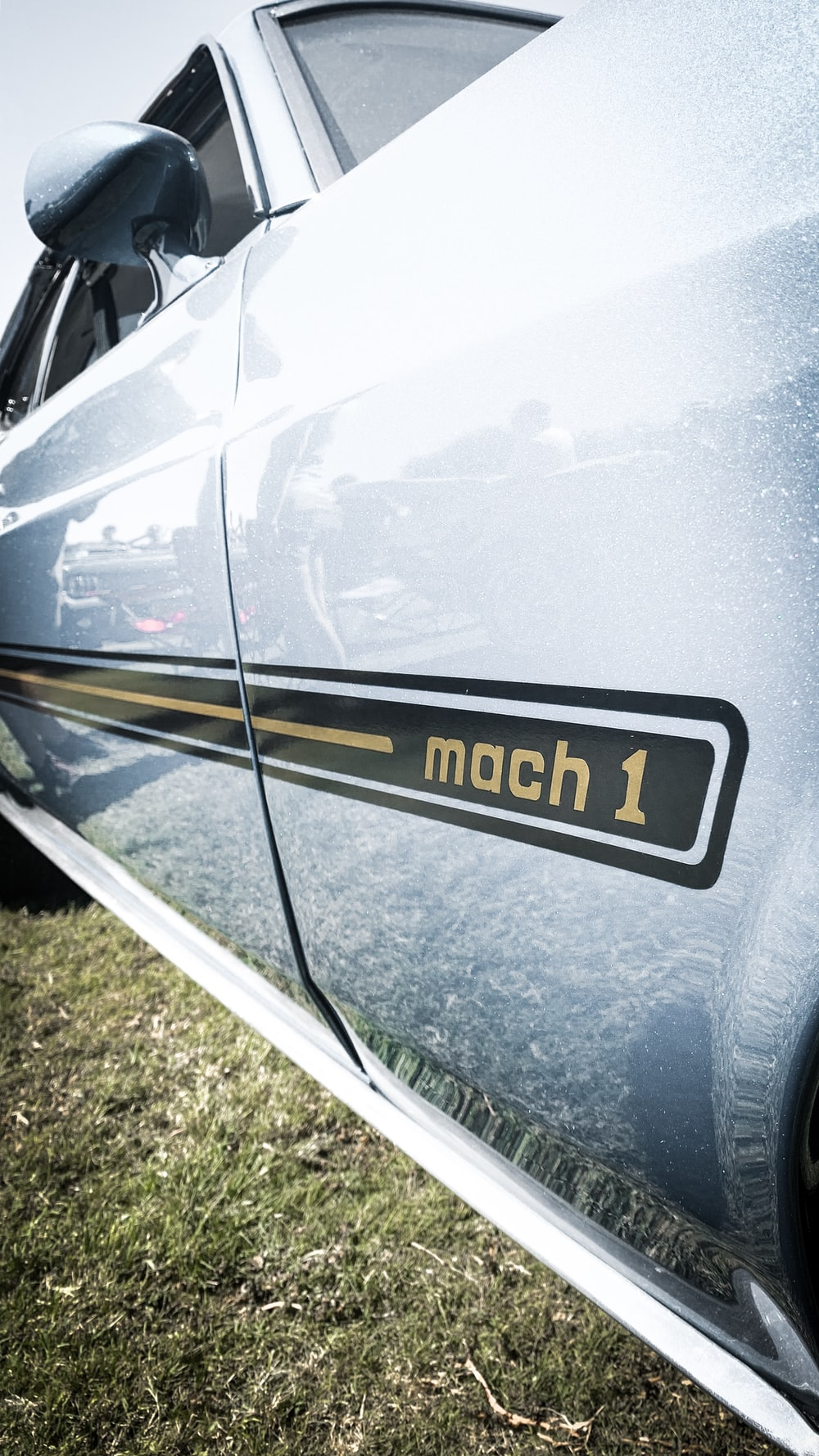 parked gray Mach 1 vehicle during daytime