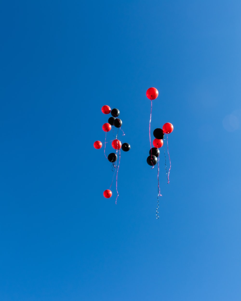 red and black balloons