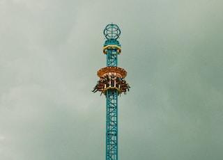 people riding tower amusement park ride