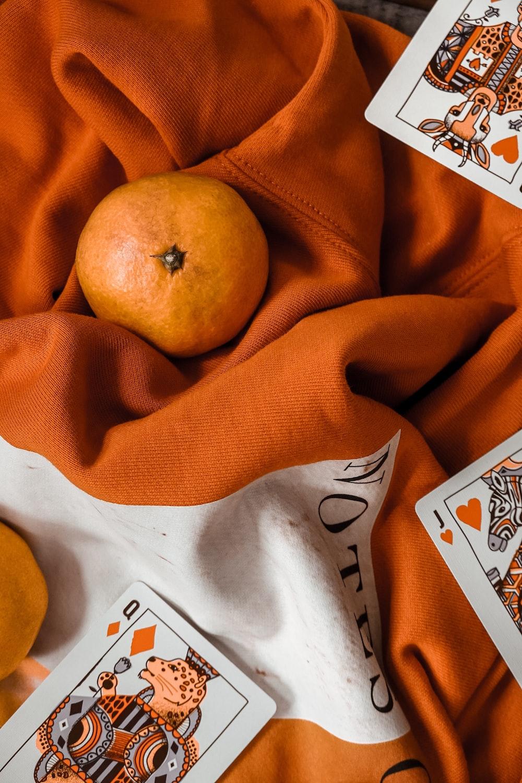 orange fruit on orange linen