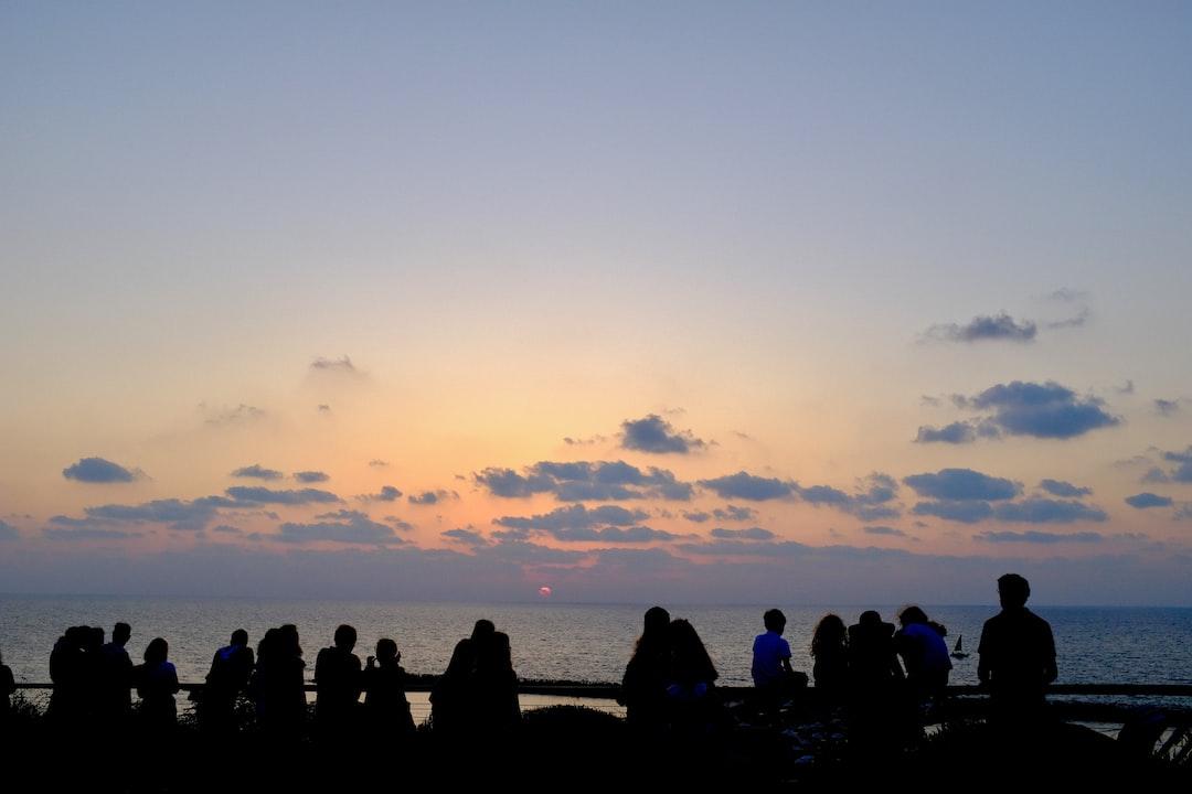Group watching sunset at topsea beach, Tel-aviv