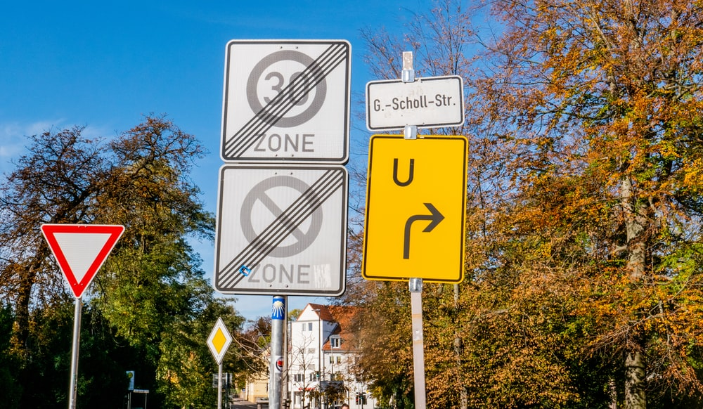 zone and u-turn road signs