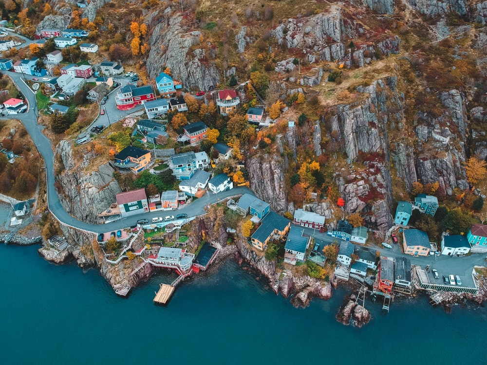 aerial photography of houses and buildings near blue body of water during daytime