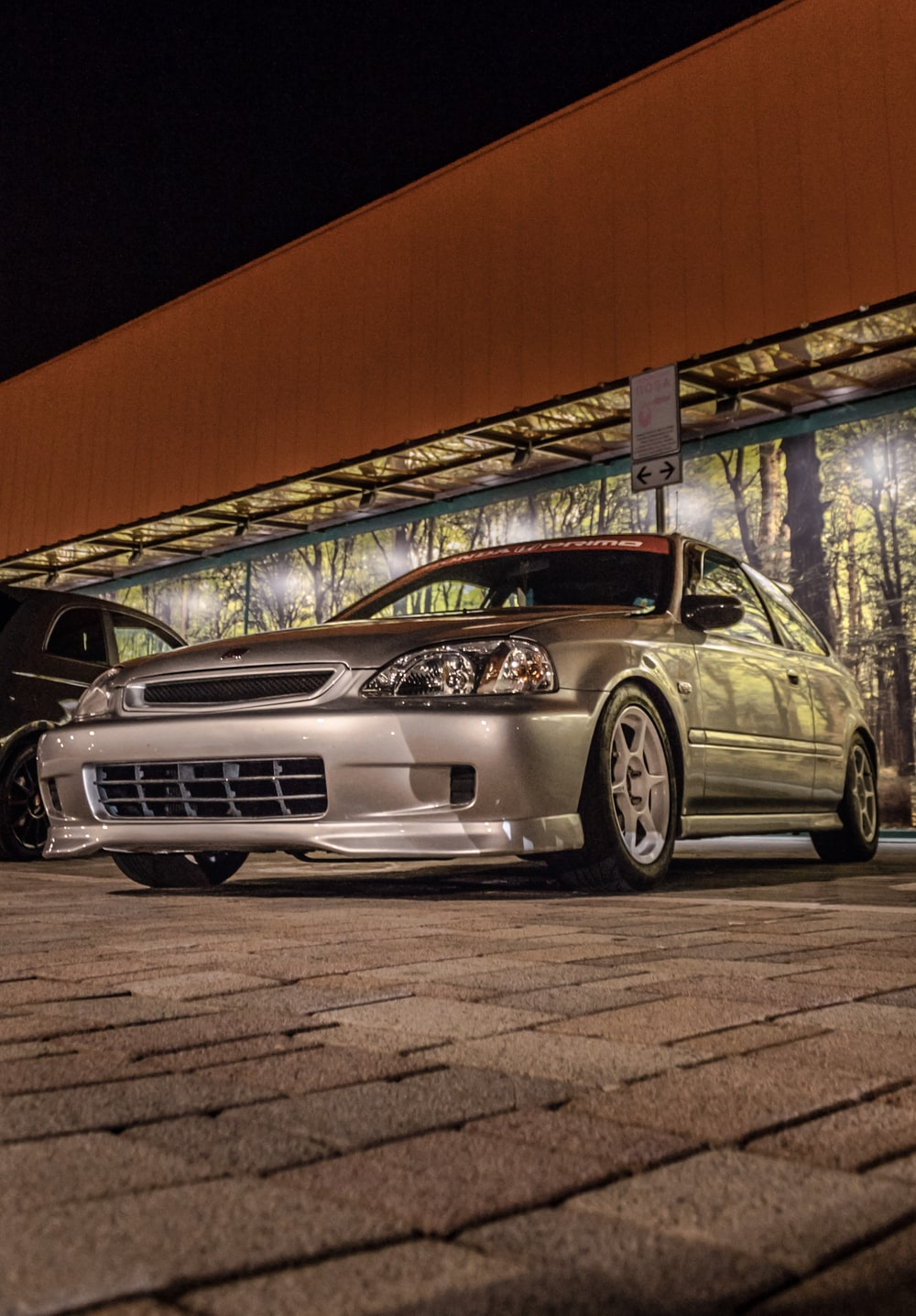 silver Nissan Skyline GT-R coupe parking