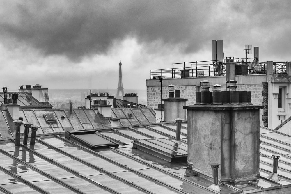 grayscale photo of rooftops