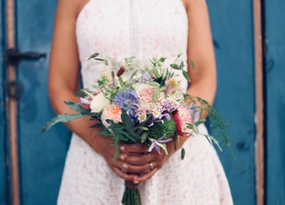 woman holding bouquet of lower