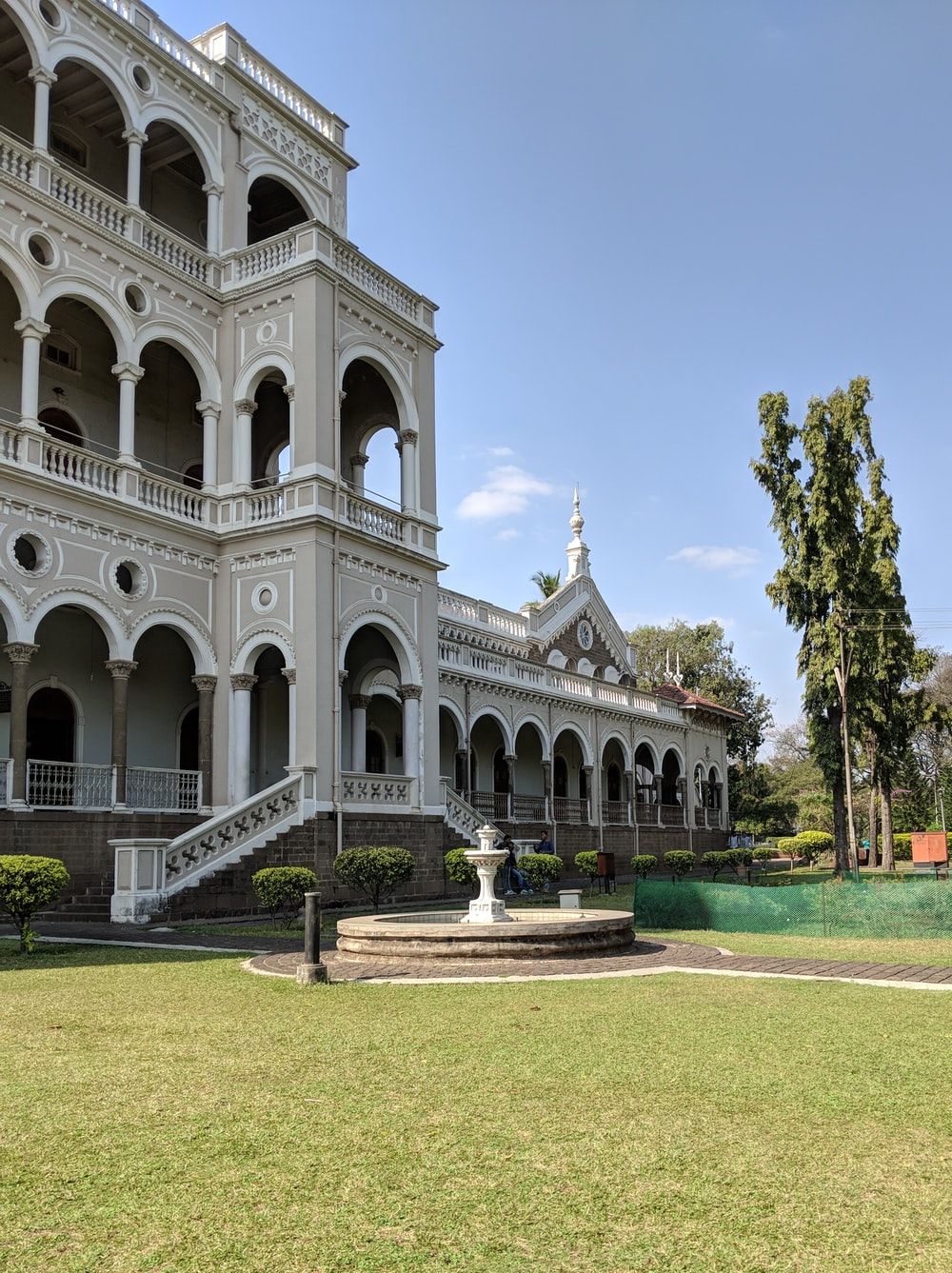 white mansion house with water fountain