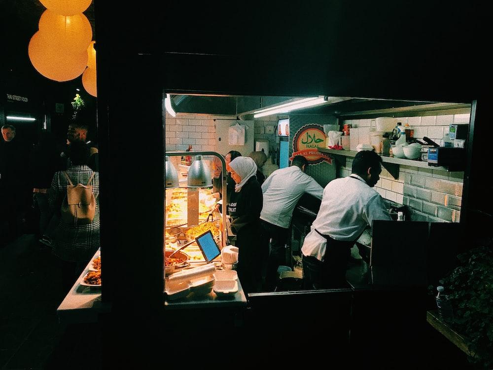 men cooking in kitchen