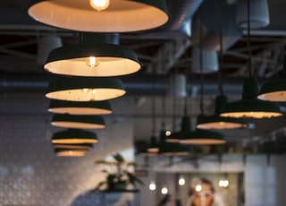 shallow focus photo of black pendant lamps