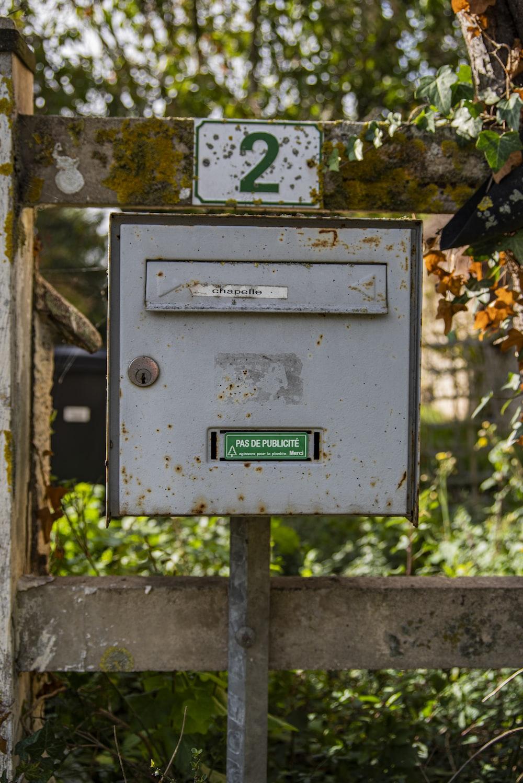 gray metal mail box during daytime