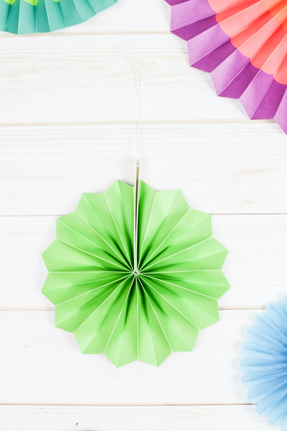 green paper decor on wall