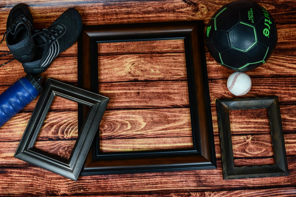three rectangular black and brown photo frames on brown surface