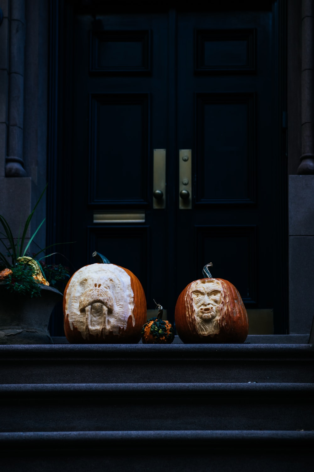 orange and brown pumpkin decors on stairs