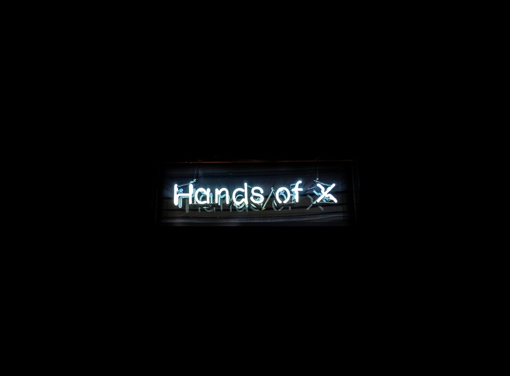 Hands of X text