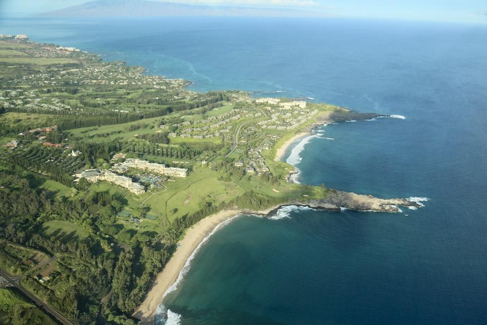 aerial view of island beside ocean