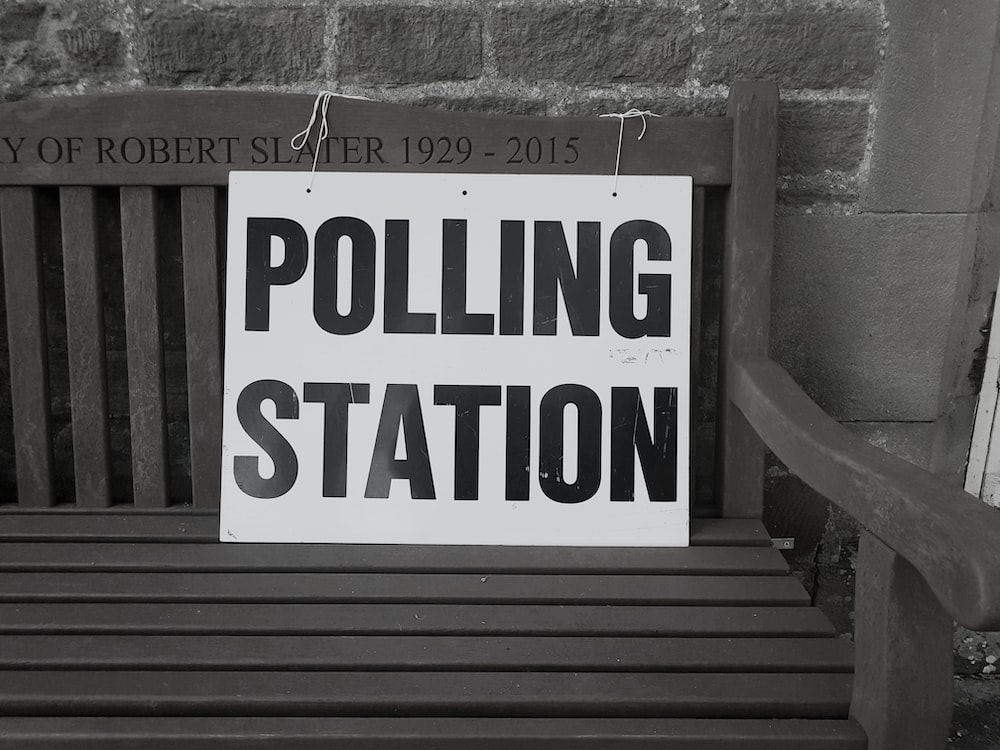 bench with polling station sign