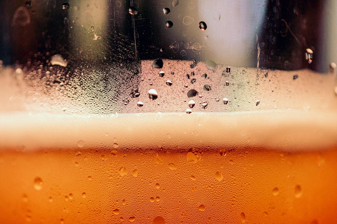 Hefe weizen beer in a plastic cup.