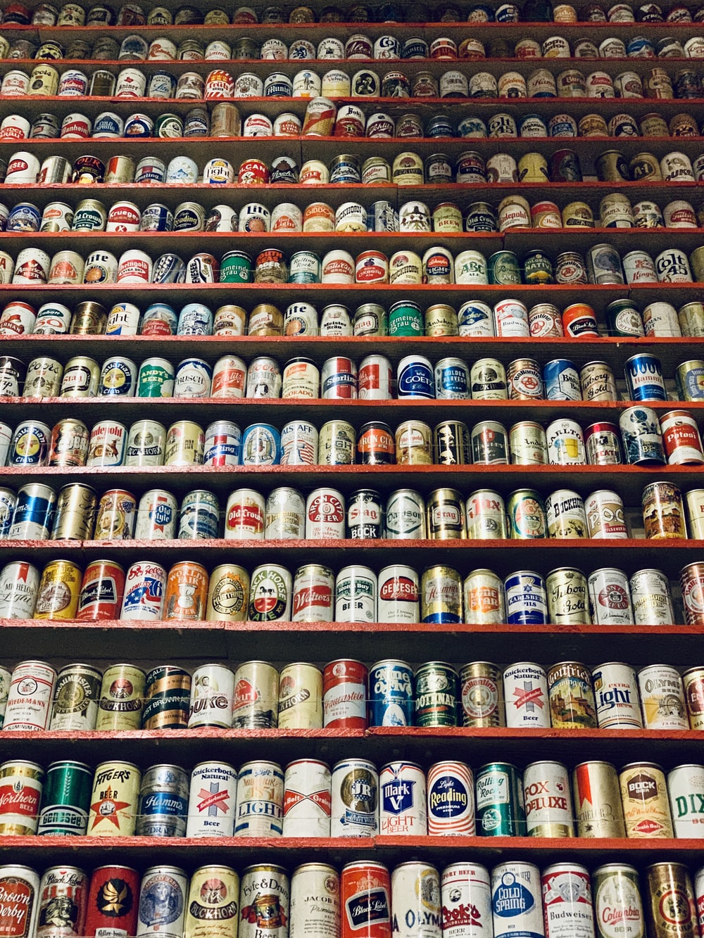 assorted-brand beverage can lot on rack