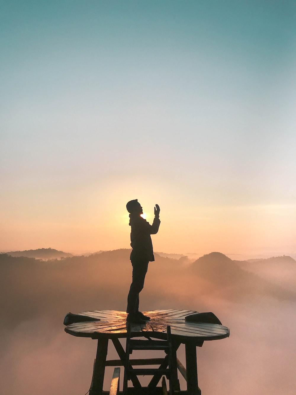 silhouette of praying man