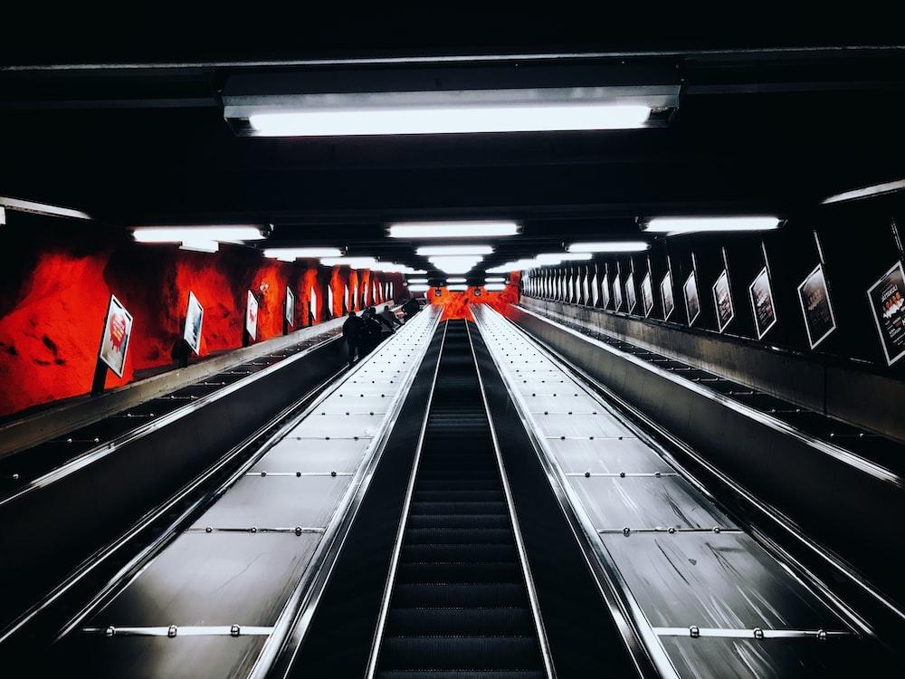 greyscale photography of escalator