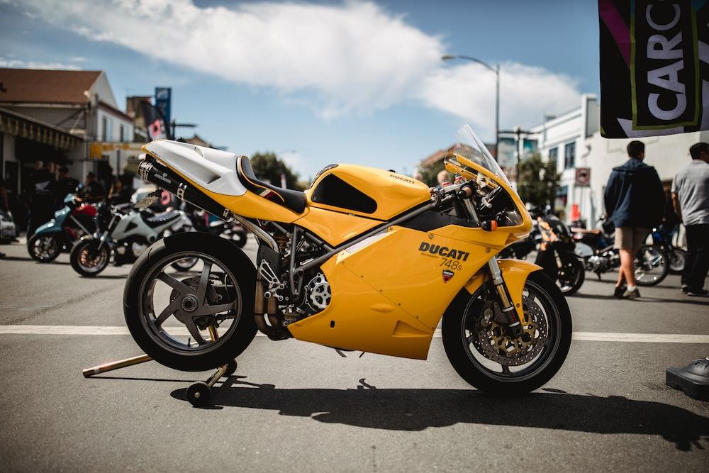 yellow and black Suzuki sports bike