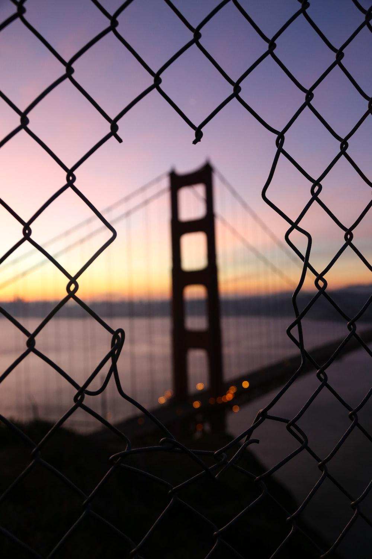 broken metal fence at night