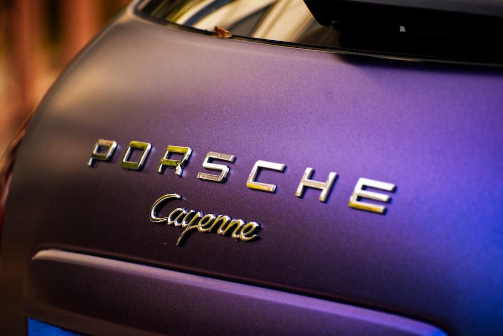 shallow focus photo of Porsche emblem