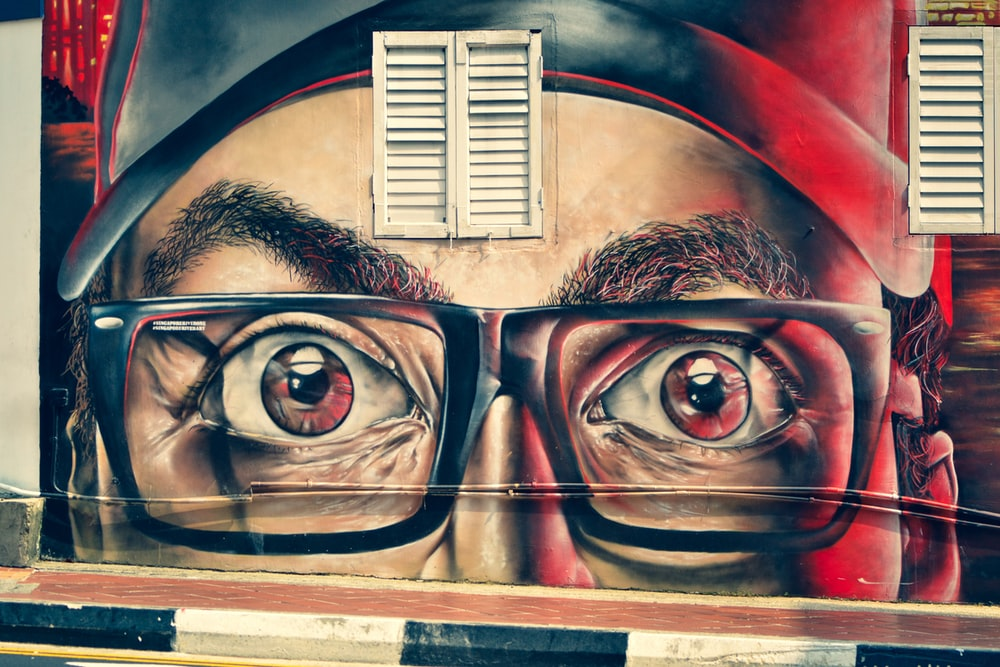 man wearing eyeglasses painting