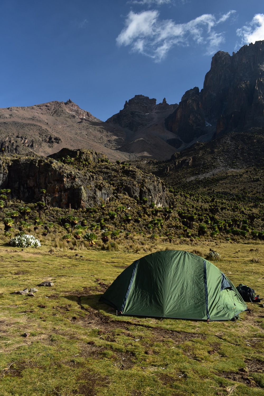 green dome tent near hills