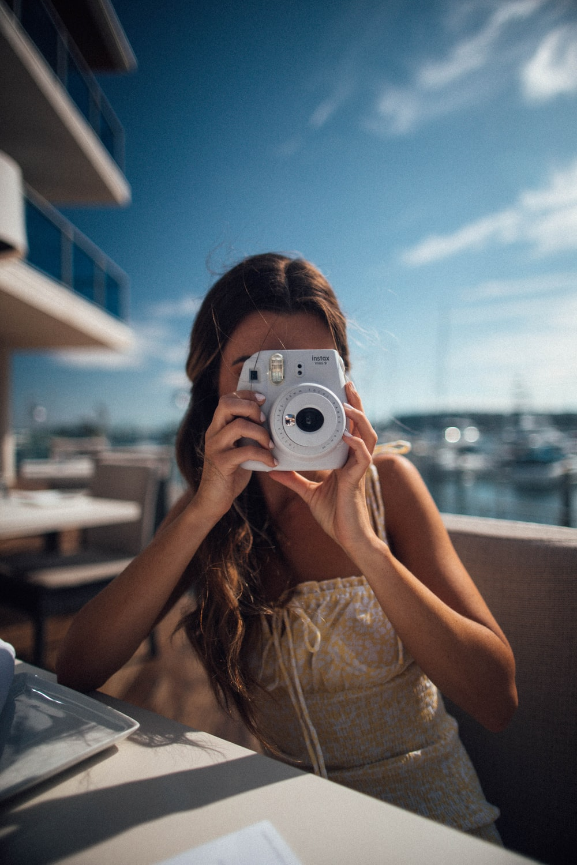 sitting woman using camera